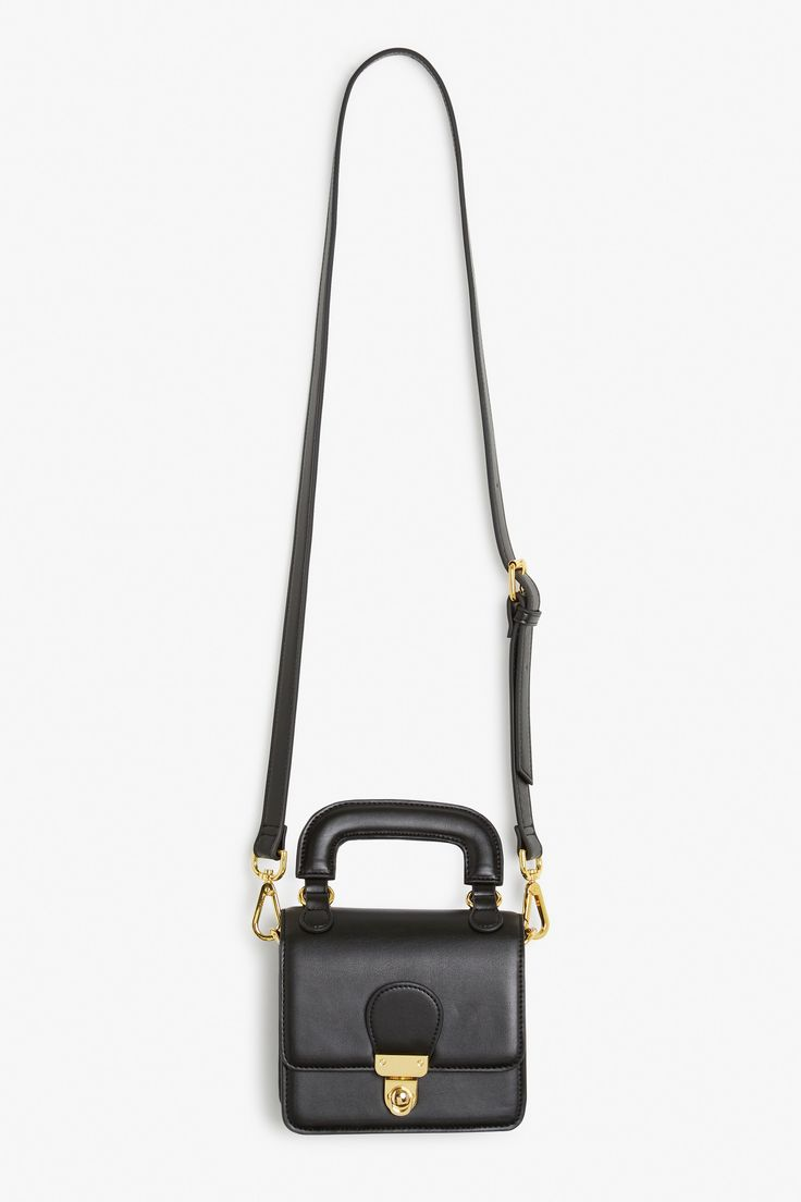 A mini, super-structured, stand-up purse that'll make you want to grab its precious handle and skip off into the sunset.