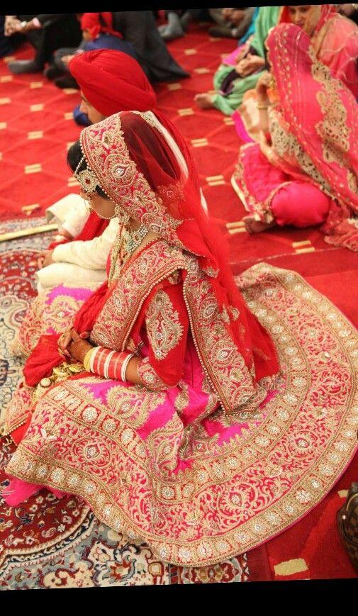Indian bride wearing bridal lehenga and jewelry. #IndianBridalHairstyle #IndianBridalMakeup