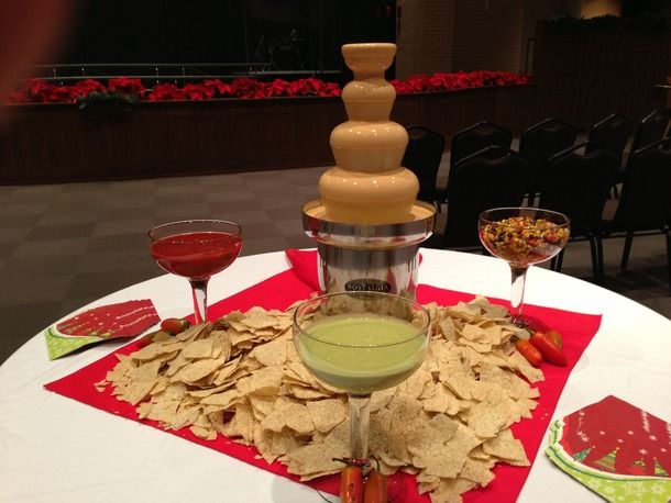 Chips And A Nacho Cheese Fountain Plus Salsa Guacamole In Margarita Glasses Coastal