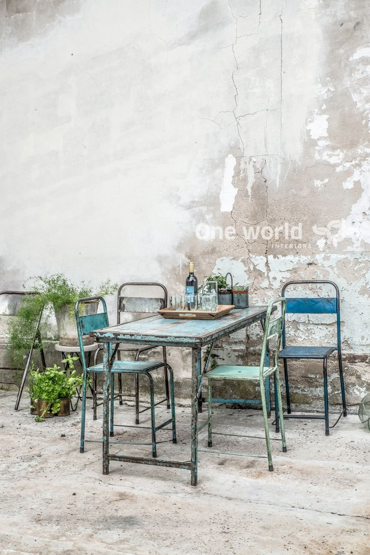 One World Interiors - Iron folding table & Java iron chairs - Picture: Paulina Arcklin
