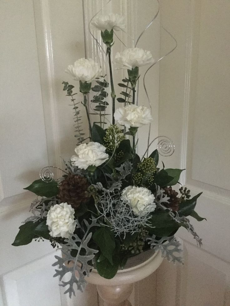 Winter whites carnations and greenery