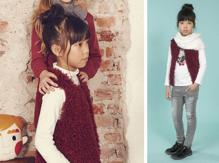 Suitable for every occasion, this long, silver-hooded jacket is warm and cosy, combined with a super cute mini dress in soft burgundy with a high collared tricot featuring romantic, lace detailing.  Scarf 4N181, Gilet 4N979, Roundneck 4N929, Denim 4N948. 3-16 yrs