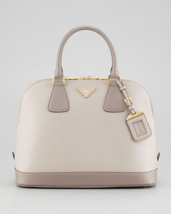 For more looks like this follow my bags board @suhmyyuh #Prada Saffiano Bicolor Dome Bag