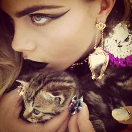 cara delevigne with baby animals and sequins.  sick editorial.