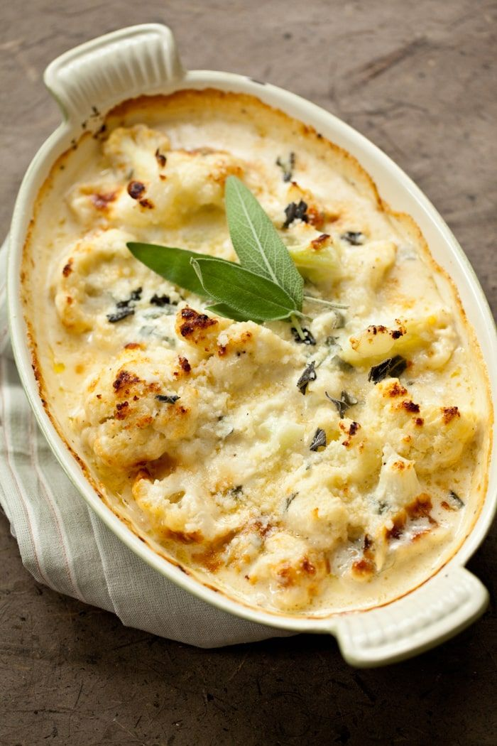 A rich, creamy baked cauliflower side dish with mascarpone, heavy cream and parmesan cheese, seasoned with fresh sage. Perfect for holidays or any time.