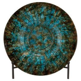 """Add a pop of color to your entryway console table or living room etagere with this eye-catching charger plate, showcasing a crackle finish in blue.  Product: Charger plate Construction Material: Iron and glassColor: BlueFeatures: Crackled finishDimensions: 18"""" Diameter x 2"""" DNote: Plate stand not included"""