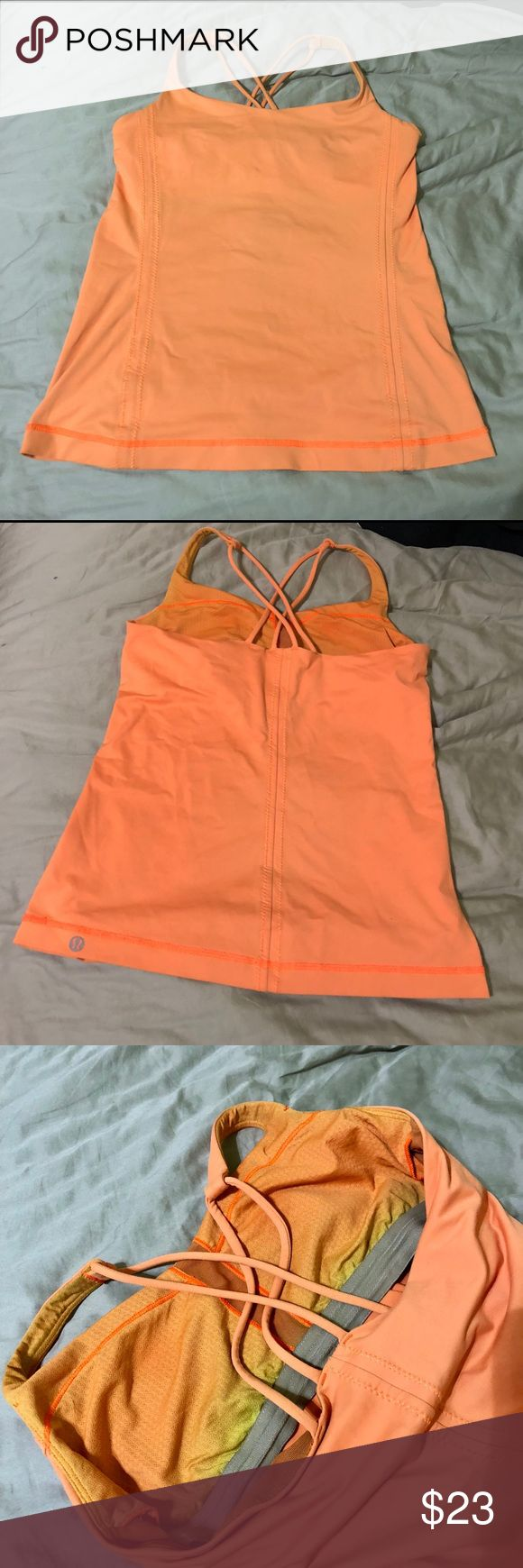 """Lululemon orange strappy top with shelf bra Lululemon orange strappy top with shelf bra. Well loved but in excellent condition, slightly faded on inside. Notice length, shirt was hemmed (I'm 5'2"""") lululemon athletica Tops Tank Tops"""