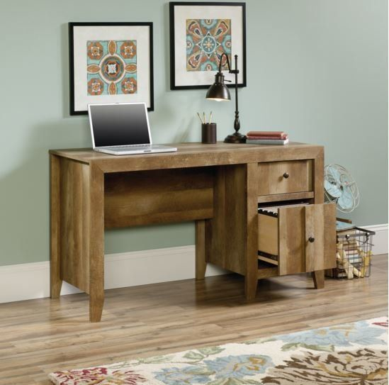 <p>Build your dream work space with the Signal Mountain Writing Desk.</p><p>Made in the USA, this timeless design is finished in craftsman oak for a rustic look. Each of its 6 legs are tapered for a classic base design. The right side offers up 2 drawers of storage space, each of which is adorned with a classic knob pull.</p><p>Pull up a cozy leather rolling chair and add a glowing lamp to craft a stately study ensemble, or keep it simple with a metal c...