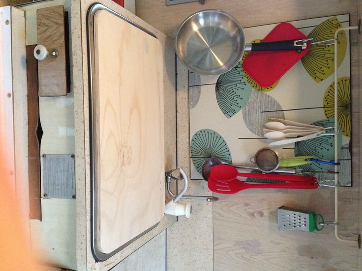 Chopping board made to cover sink and create more bench space