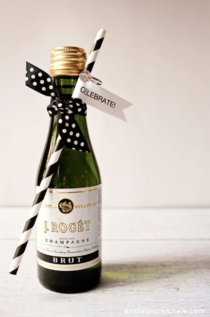 Give each guest an accessorized mini bottle of Champagne. | Community Post: 30 Swoon-Worthy Engagement Party Ideas