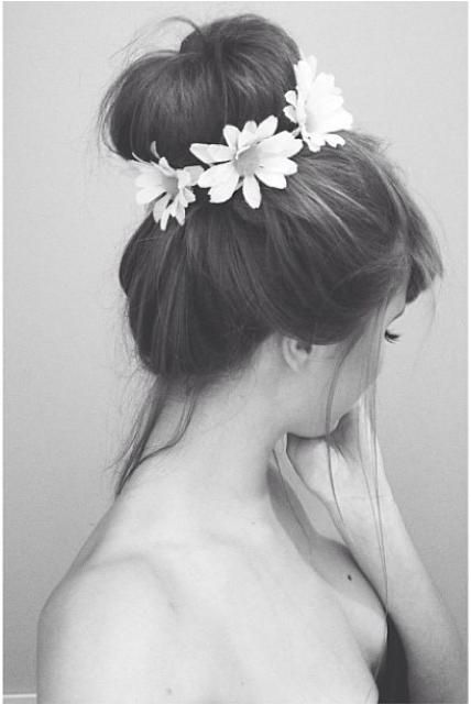 A daisy-wrapped bun couldn't be more romantic. #hair #flowercrown
