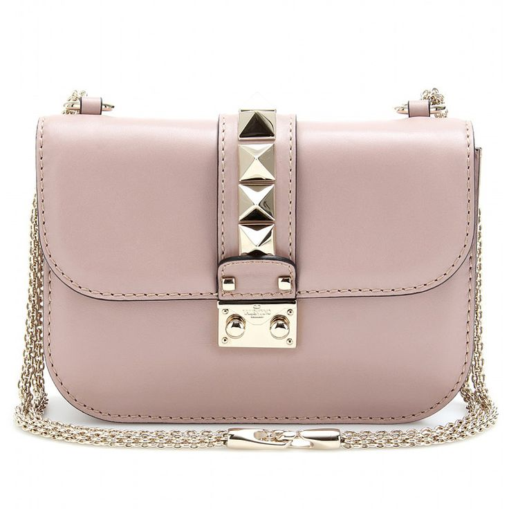 Being ladylike doesn't mean you can't rock. Hence the pyramid studded @Maison Valentino bag. Love.