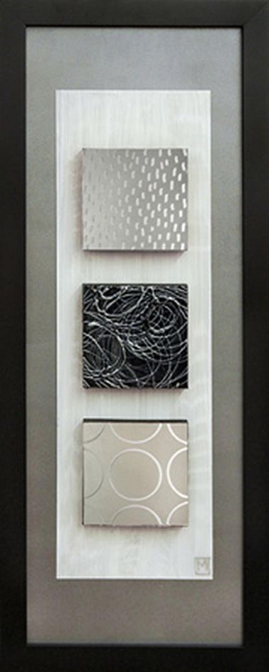 In this piece, Manuela Jarry has painted on 1 wood block and 2 mirrored blocks with texture and high-gloss. The blocks are mounted on a designer matboard and then mounted on a second matboard and framed with a brown finished moulding.