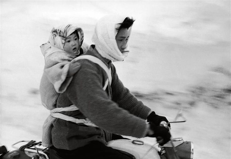 © Fosco Maraini, Woman and child on a motorcycle, Utoru village