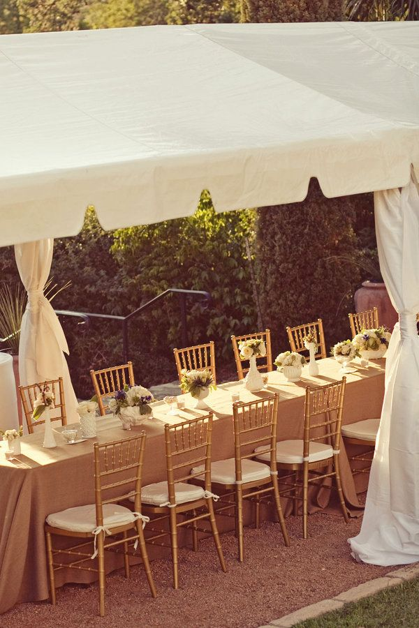 Love the marquee tent with table underneath!