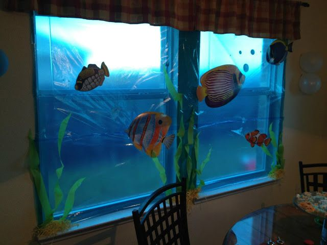 """use blue cellophane to cover windows and add underwater creatures to feel """"under the sea"""""""