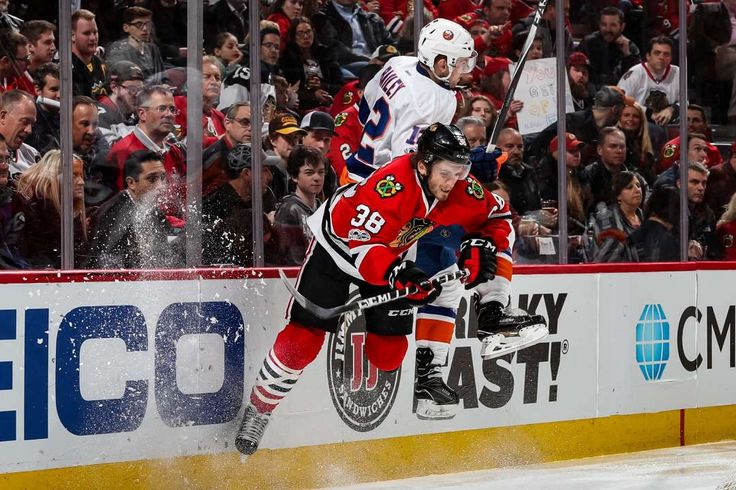 Into the air: Josh Bailey of the New York Islanders checks Ryan Hartman of the Chicago Blackhawks in the second period at the United Center on March 3 in Chicago.