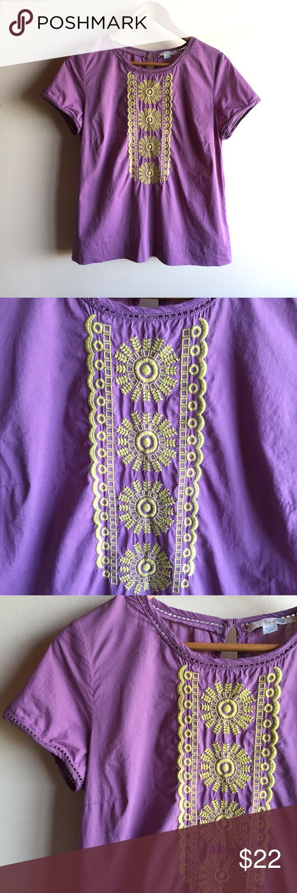 "Boden purple embroidered blouse Purple short sleeve top with golden yellow embroidery. 100% woven cotton. Great condition except for a couple of small picks in the fabric towards the bottom..see last pic. Measures 20"" from underarm to underarm and 25"" long. Boden Tops Blouses"
