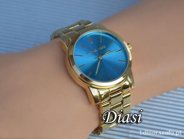 Zegarek Michael Kors złoty z niebieską tarczą   Cena: 140,00 zł  #zloty #nowy #niebieska #zegarek #michaelkors #tarcza