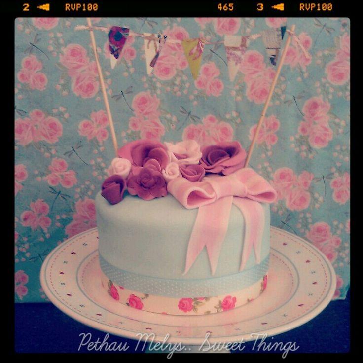 Bunting, roses, vintage cake
