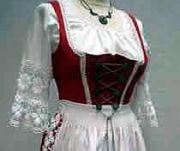 Bavarian Dirndl Dresses.  Click through for history of Drindl Dresses and Lederhose - Traditional Bavarian Tracht.  Originally the dirndl was the working dress of female servants.  Today it is the uniform for waitresses in many traditional Bavarian restaurants - but more than that it is fashionable throughout Bavaria to wear Tracht - both of rough cotton/linen, but also of silk, satin, etc.  Pinned by www.mygrowingtraditions.com