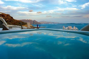 Take in stunning views of the Aegean while relaxing pool-side at The Mystique Santorini