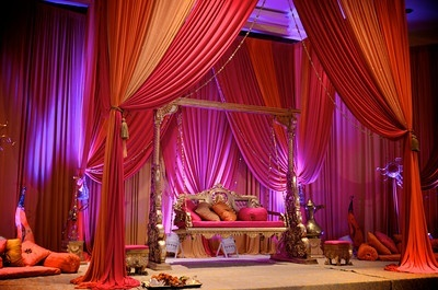 Indian wedding stage, fabric draping decor at wedding reception, head table