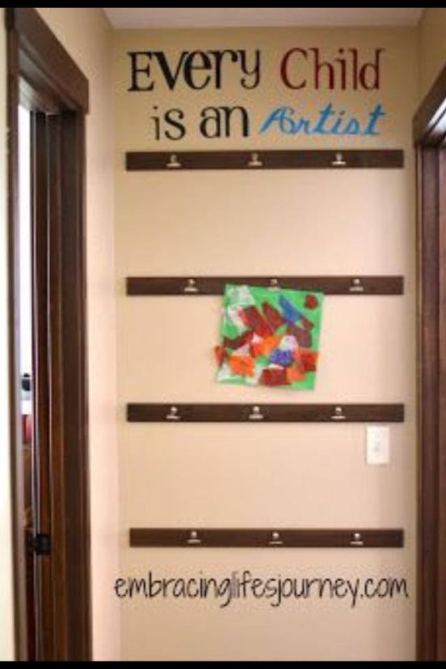 Art wall! LOVE THIS!! I so want to do this for all of Evan's drawings :)