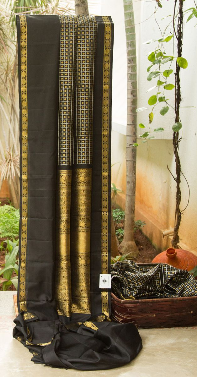 This black kanchivaram silk with golden motifs all over the body and a traditional indian pattern on the border in black and gold. The grand pallu with solid gold zari work magnifies the wonder of ...