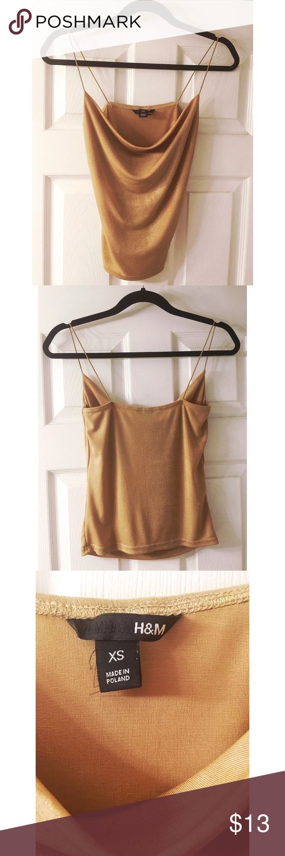 Shimmering Gold Cowl Neck H&M Top -Brand: H&M -Size: XS (super stretchy) -Color: Shimmery Gold -Condition: Excellent -Cheaper on Ⓜ️ -Deeper discounts when you bundle   Tags: Free People Top Shop Aeropostale Anthropologie H&M Forever 21 Fashion Nova American Apparel Urban Outfitters Pacsun Tillys Missguided Billabong American Eagle Hollister Abercrombie Aldo Nasty Gal Hot Topic Yandy Beach Bunny Victorias Secret Boohoo Asos Unif F21 Cosabella Bebe Zara Balmain Fashion Nova Steve Madden Sam…