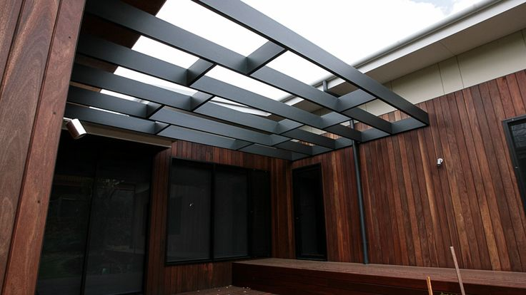 Spotted gum cladding, eposed patio beams, country home