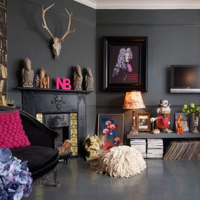 A colorful and eclectic collection of ornaments against a dramatic backdrop of grey floor with matching walls.