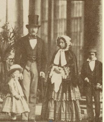 Queen Victoria and Prince Albert with Prince Edward and one of the Princesses, either Louise or Helena.