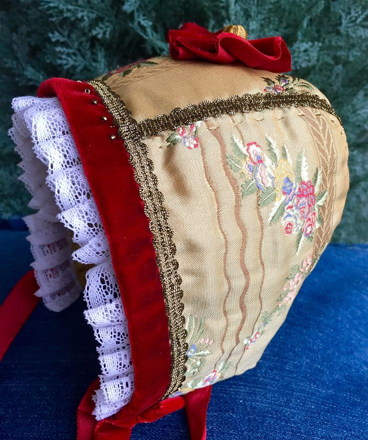 Christening bonnet, decorated with lace and beads. Handmade.