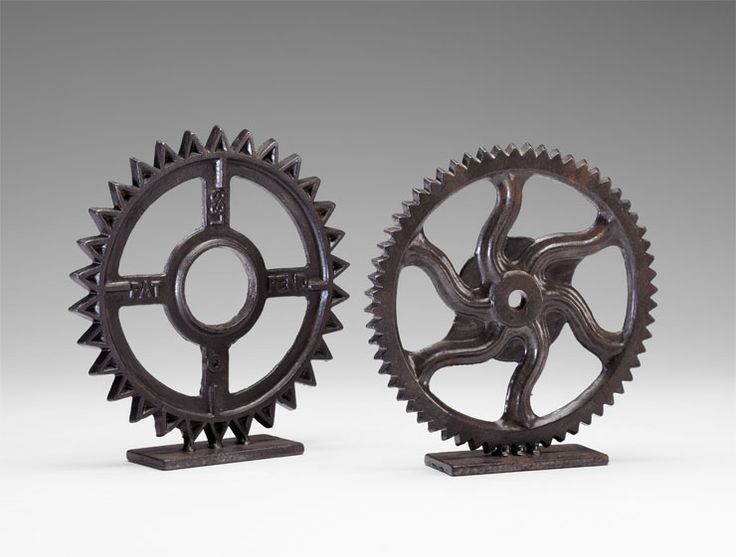 Gear Sculptures: Industrial modern works of art. Each gear is finely crafted of heavy iron in a bronze finish. These masculine sculptures are an excellent choice for adding texture and movement to a desktop or bookshelf, or for a modern paperweight in the office or study. Choose from two styles of lifelike gears, sold individually, or select both styles for a distinct collection. Truly an excellent gift for the hardworking man, or for your own handsome tabletop decor. $50.00–$52.50
