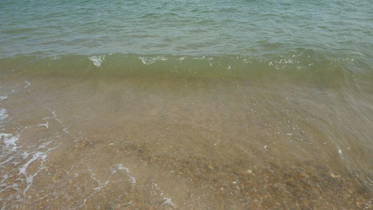 Small Wave on a shingle beach