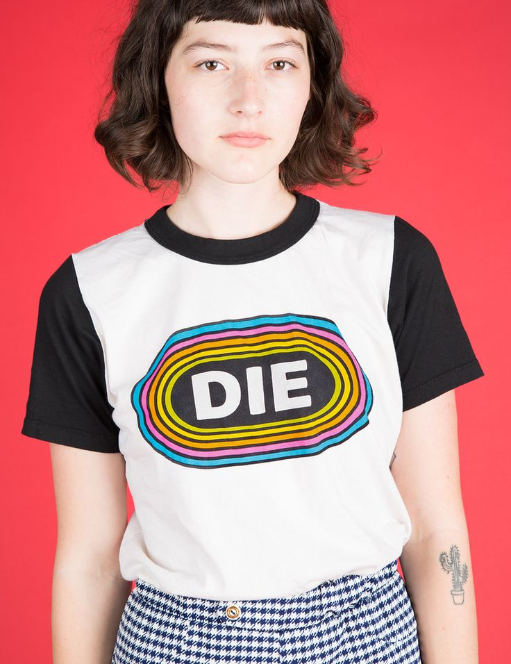 DIE, DIE, DIE. Show the world how you really feel! 1970s inspired fit and details. Athletic styled color blocked sleeves and neck. Vintage broken-in feel. Super