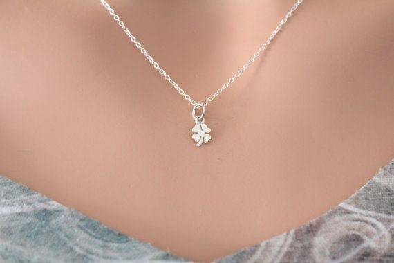 This is a Sterling Silver Tiny Four Leaf Clover Charm Necklace. Both the charm and the necklace are Sterling Silver. Please look at the measurements of the charm before ordering. Photos can sometimes make charms appear larger or smaller than they actually are. Measurement of Charm in mm: Height: 12 Width: 5 Thickness: 1 (height includes jump ring)  Measurement of necklace length in Inches: You will be able to select a 16, 18, or 20 inch chain. There are two types of chains, the regular chain…