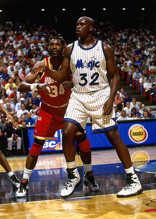 """retro-nba: """"June 7, 1995: Veteran Hakeem Olajuwon of the Houston Rockets goes against the rising dominance of Shaquille O'Neal of the Orlando Magic in Game 1 of the NBA Finals. """""""