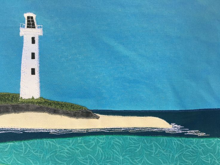 Coastal scene designed for my Dad's 70th birthday. Rottnest Island lighthouse. Hand embroidery, free motion machine stitching and applique. Driftwood for hanger.