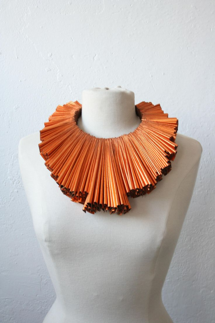 Necklace | Mia Morikawa  ~ Kapow Wow Designs.   Recycled pleated faux-leather.  Not sure but i might just like it because its orange ha ha.