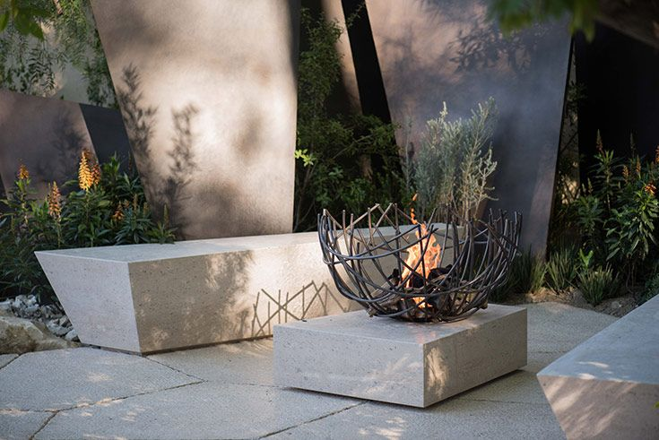 interesting outdoor firepit and geometric benches   adamchristopherdesign.co.uk