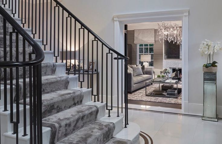 Elegant entrance hallway with the new sweeping marble staircase we designed and dark bronze balustrade. I love the double doors we added to the formal living room, hung on parliament hinges which allow you to fully swing the doors open against the wall. . . . . #hallwaydecor #hallway #hallways #decor #balustrade #staircase #staircases #stairrunner #marble #marblestaircase #marblefloor #interiordesign #interiordetails #details #luxuryhomes #luxurydesign #luxurydecor #luxuryhouse…