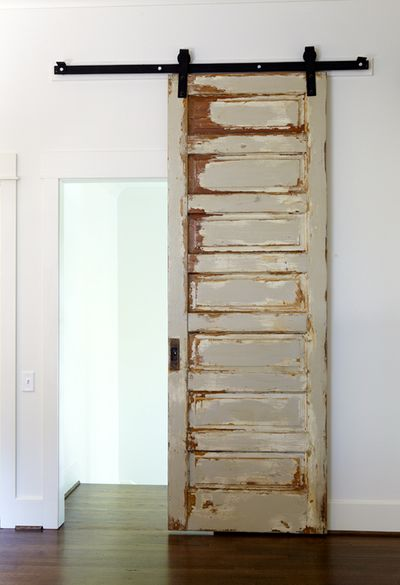 Make a standard door a sliding door using barn door hardware. (use my vintage mirror door}