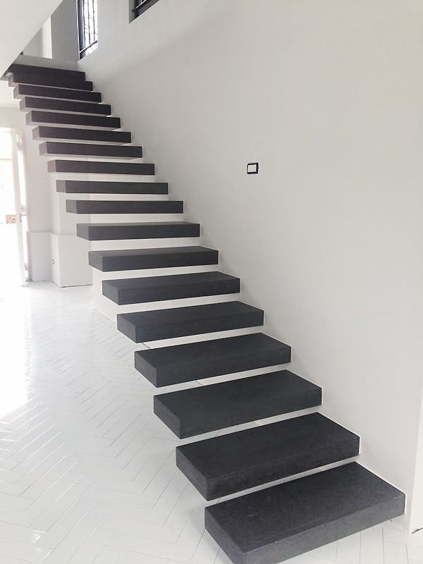 Natural Gray lava stone floating steps. Glazed lava stone tiles, glossy white, for the flooring.