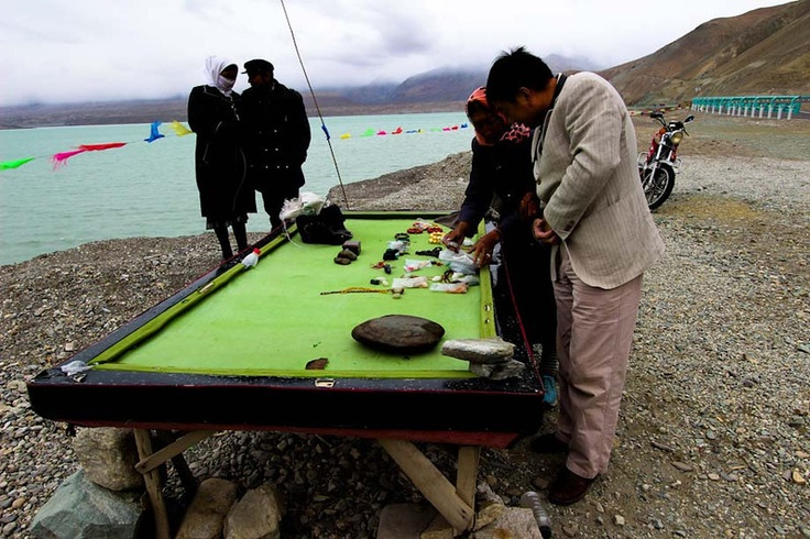 Karakorum Highway/ I played pool on a table like this one outside in Tashgurgan where they told me it hadn't rained in 10 years.They are using it here as a sale table to display their crystals& gemstones for sale. (jwmc)