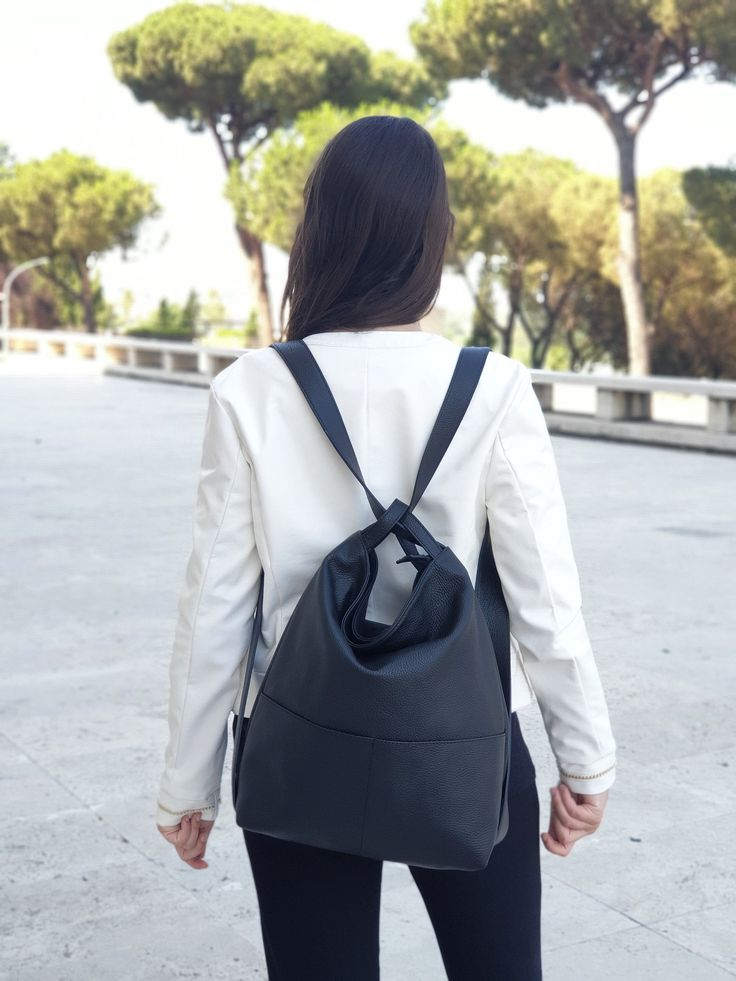 Photo of Convertible backpack bag in black leather. Handmade unisex soft leather bags. Italian Handcrafted Leather Goods. Gift idea from Ganza