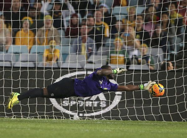 Orlando Pirates goalkeeper Senzo Meyiwa dives but fails to stop the ball going below his hand, from a free kick by Tottenham Hotspur Rafael Van der Vaart, during the 2011 Vodacom Challenge at Ellis Park stadium in Johannesburg, South Africa.