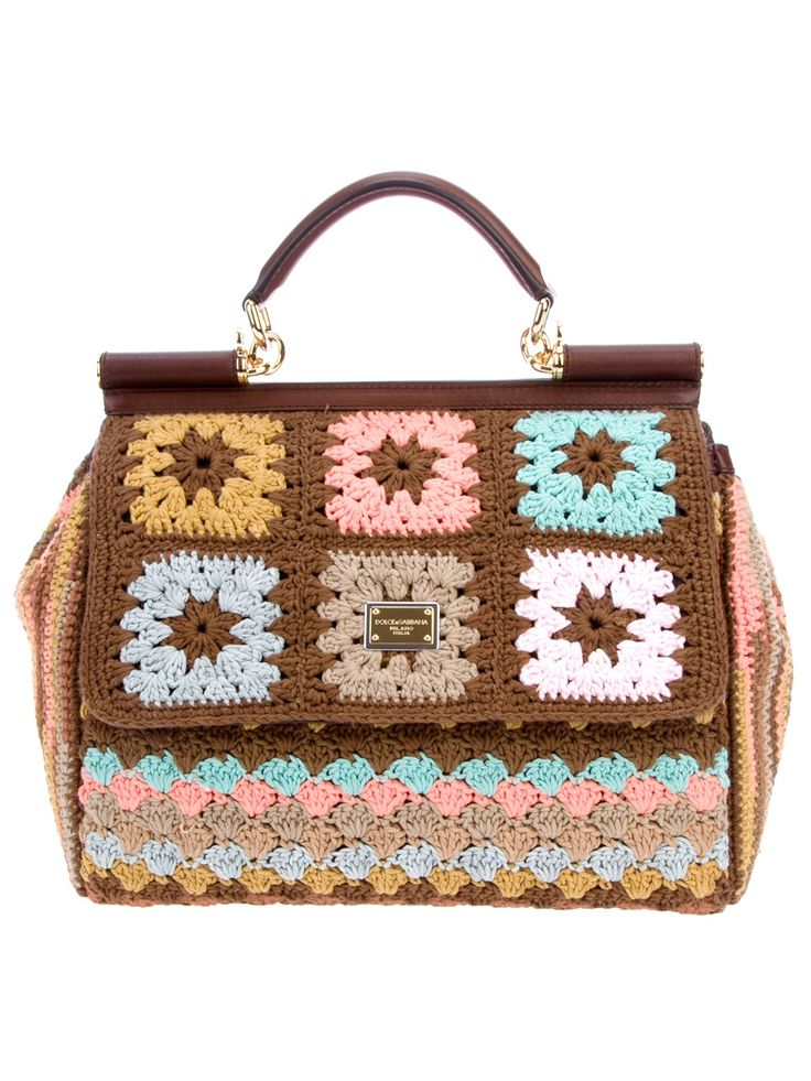 Dolce & Gabbana Crochet Shoulder Bag Brown cotton and leather crochet shoulder bag from Dolce & Cabbana featuring a multicolor multi-patterned crocheted yarn design, leather top handle with gold-tone links, removable and adjustable cross-body strap, flap top with magnetic snap closure, two-tone Dolce & Gabbana plaque detail at the front and inside zip and open pockets.