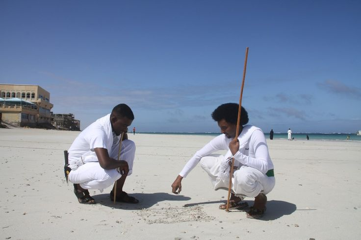 Two men in traditional Somalia Afro dress match in Liido Beach in Mogadishu.  This tradition is a invaluable tradition that existed thousands of years.